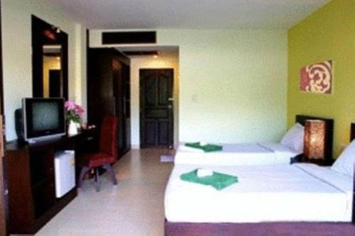 A bed or beds in a room at Krabi Cozy Place