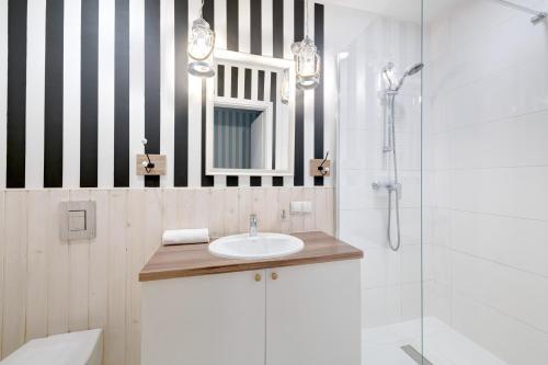 Łazienka w obiekcie 3 City Apartments - Admiralski