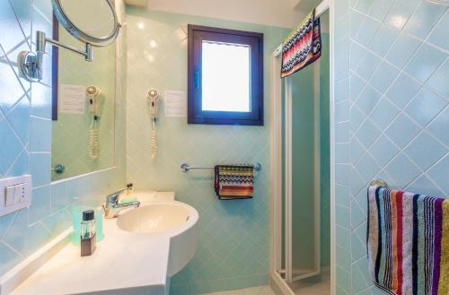 A bathroom at Centro Vacanze Isuledda