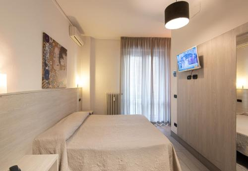 A bed or beds in a room at Hotel Careggi