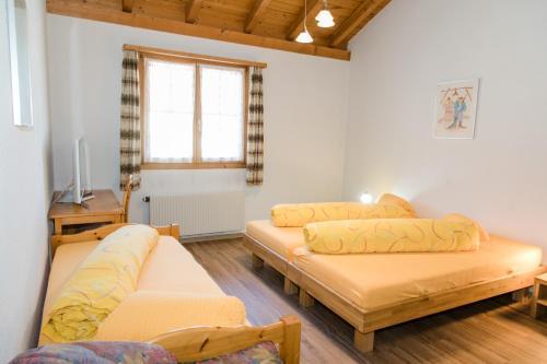 Кровать или кровати в номере Hotel Reich