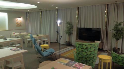 Televisi dan/atau pusat hiburan di Capsule Inn Kamata