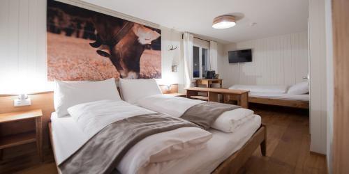 Кровать или кровати в номере Hotel Kaiserstuhl