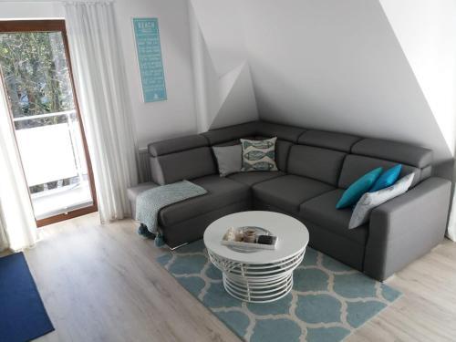 A seating area at Apartament REDA