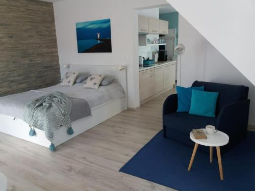 A bed or beds in a room at Apartament REDA