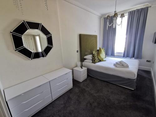 A bed or beds in a room at The Clarendon Royal Hotel