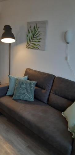 Ein Sitzbereich in der Unterkunft Bij De Vuurtoren