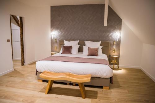 Un ou plusieurs lits dans un hébergement de l'établissement Maison d'Hôtes Les Jardins de Madeleine
