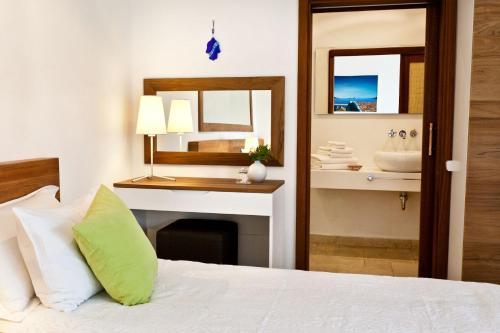 Кровать или кровати в номере Hotel Villa Mahal