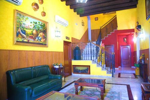 El vestíbulo o zona de recepción de Hospedium Hotel Rural Soterraña