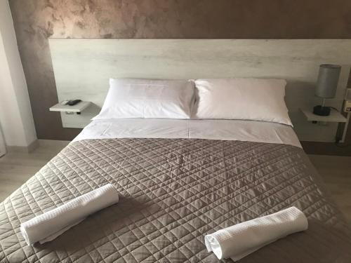 Ein Bett oder Betten in einem Zimmer der Unterkunft Albergo Ristorante Uspa