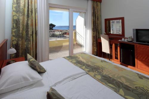 Postel nebo postele na pokoji v ubytování Dorijini Dvori