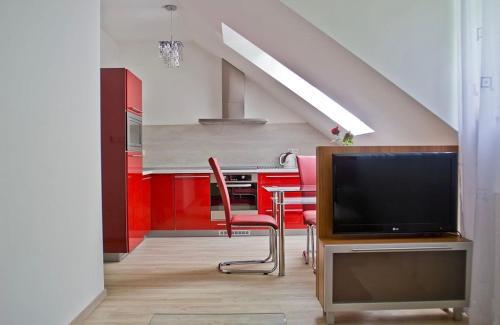 TV a/nebo společenská místnost v ubytování Vila Hedvika