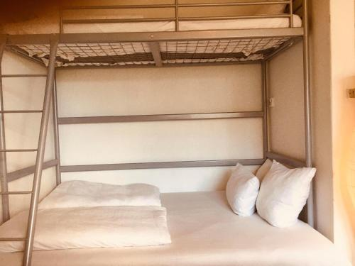 A bunk bed or bunk beds in a room at Nice room in apartment in Amager