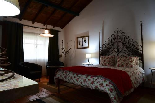 Uma cama ou camas num quarto em Quinta dos Trevos - Artes e Ofícios