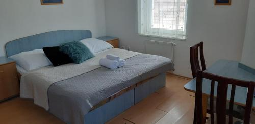 Posteľ alebo postele v izbe v ubytovaní Guest House Maxim
