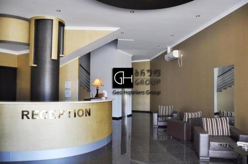 Лобби или стойка регистрации в Отель Шайн Палас