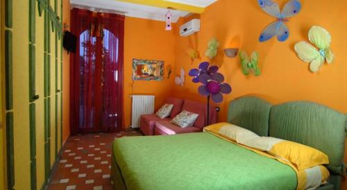 A bed or beds in a room at La Dimora Le Fumarole B&B