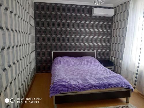 Cama ou camas em um quarto em Ramin Villa