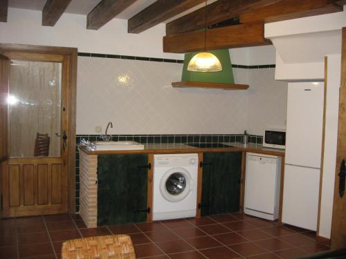 Una cocina o kitchenette en El Rincón de la Trilla - La Era