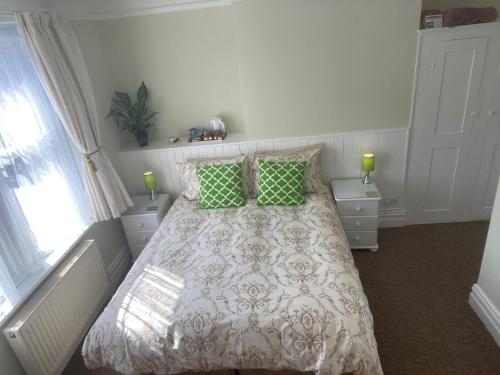 A bed or beds in a room at Rivendell Guest House