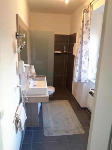 Ein Badezimmer in der Unterkunft Hotel Landhaus Appel