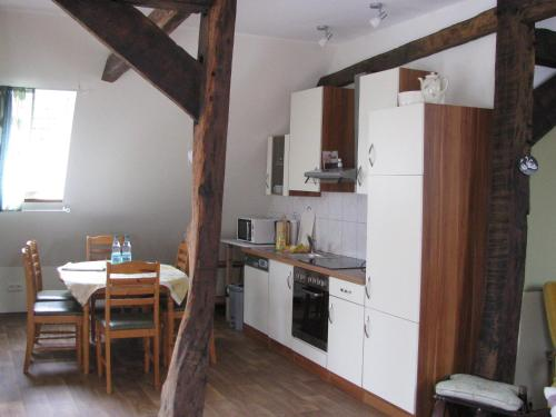 A kitchen or kitchenette at Modern Holiday Home with Sauna in Lothe
