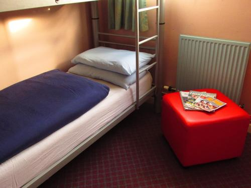 A bed or beds in a room at Broadford Youth Hostel