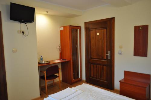 Telewizja i/lub zestaw kina domowego w obiekcie Bankietowa Hotel & Restauracja