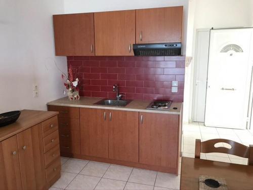 A kitchen or kitchenette at Athena Kythera