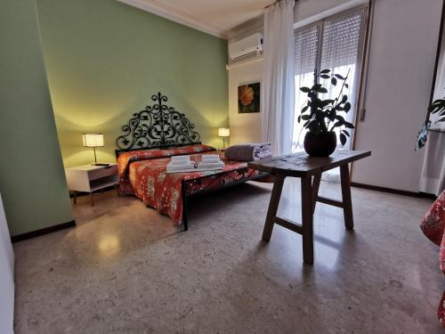A bed or beds in a room at B&B Ospedale Maggiore Parma affittacamere