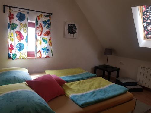 A bed or beds in a room at Thirsty River Rooms