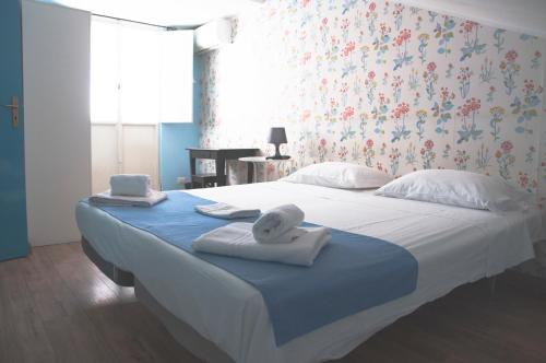 A bed or beds in a room at City-In Hostel B&B