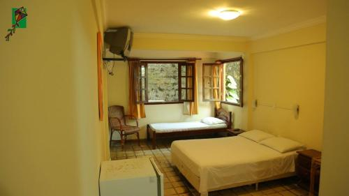 A bed or beds in a room at Hotel Morro do Careca