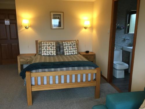 A bed or beds in a room at B&B Kilcamb