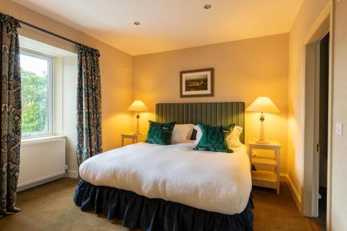 A bed or beds in a room at Isle of Eriska Hotel Spa & Golf