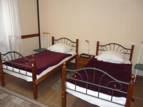 Кровать или кровати в номере Hotel Kola
