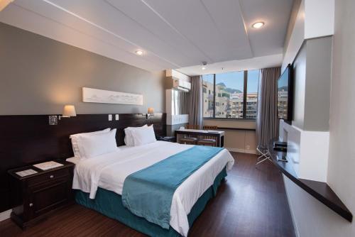 Postel nebo postele na pokoji v ubytování Sol Ipanema Hotel
