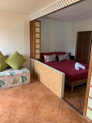 Cama ou camas em um quarto em F2 Tapu