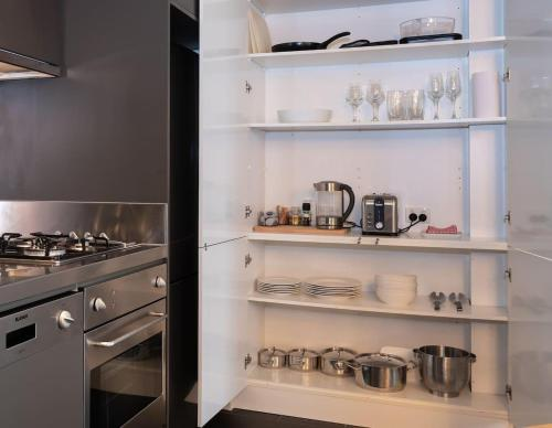 A kitchen or kitchenette at Luxury East Melbourne Apartment
