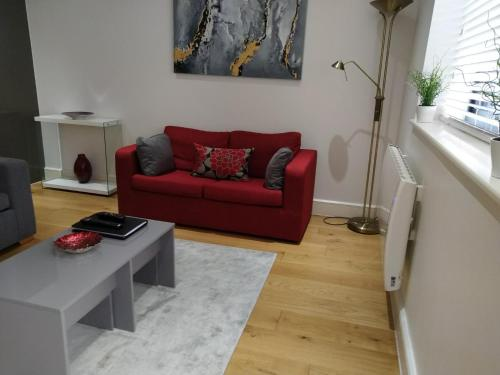 A seating area at RiiS Apartments Camberley