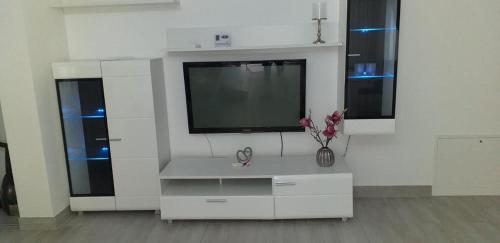 A television and/or entertainment center at apartament de lux