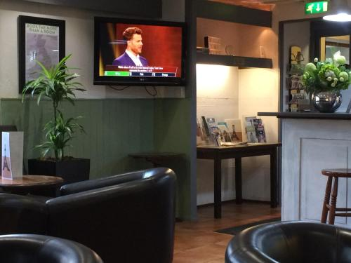 A television and/or entertainment center at Campanile Hotel Wakefield