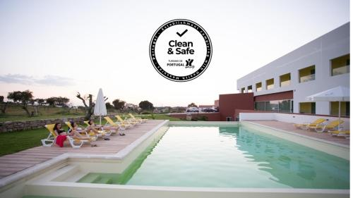 The swimming pool at or near Monte Filipe Hotel
