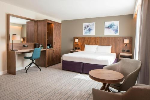 A bed or beds in a room at Courtyard by Marriott London Gatwick Airport