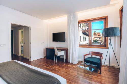 A television and/or entertainment center at Iberostar Heritage Grand Mencey