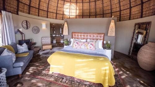 A bed or beds in a room at Gondwana Game Reserve