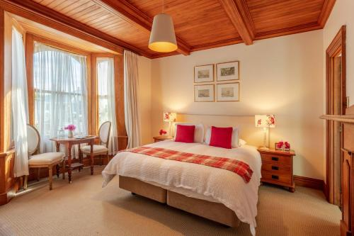 A bed or beds in a room at French Bay House