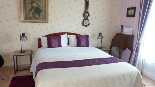 Cama o camas de una habitación en Chambres d'Hôtes Les Vieilles Digues
