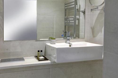 A bathroom at Trafford Hall Hotel, BW Signature Collection by Best Western